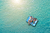 Happy family on inflatable bed on the sea