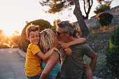 istock Happy family on nature on sunset 1268440443