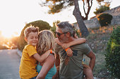 istock Happy family on nature on sunset 1268440444