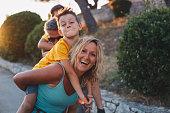 istock Happy family on nature on sunset 1268440445