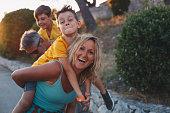 istock Happy family on nature on sunset 1268441913