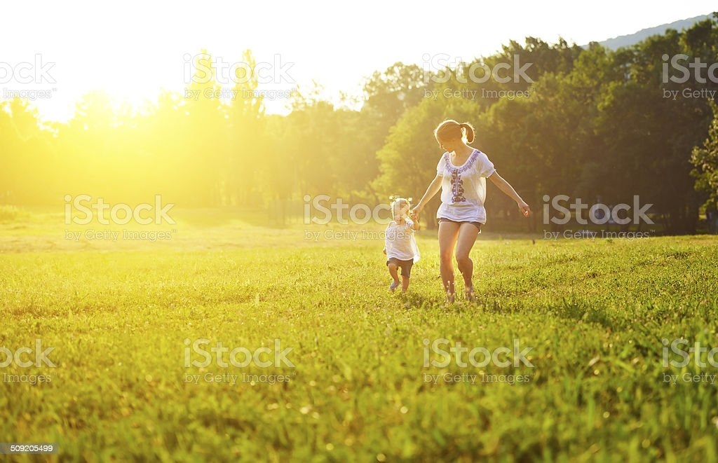 happy family on nature walks in the summer stock photo