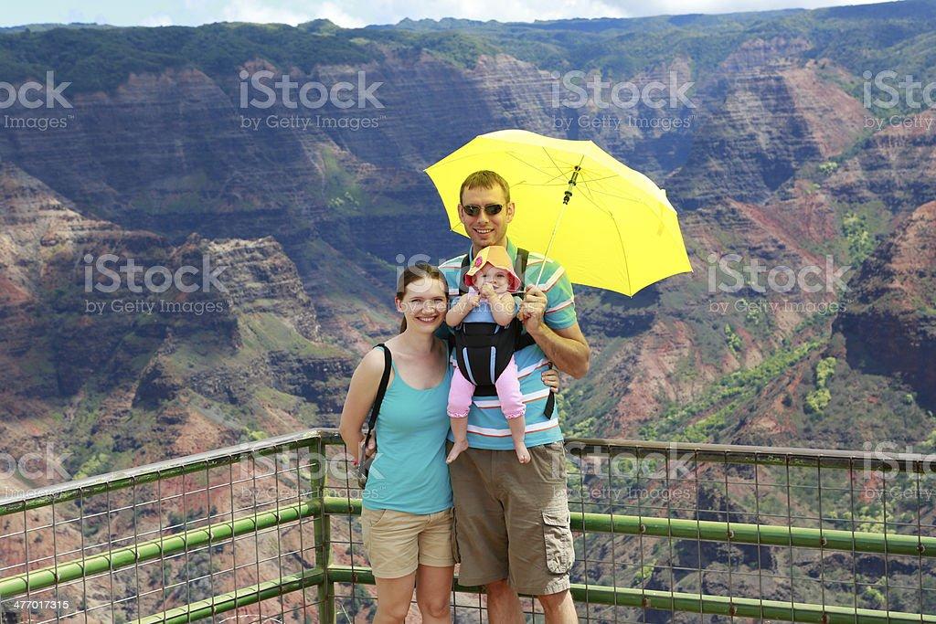 Happy family on the observation deck of Waimer Canyon. Hawaiian stock photo
