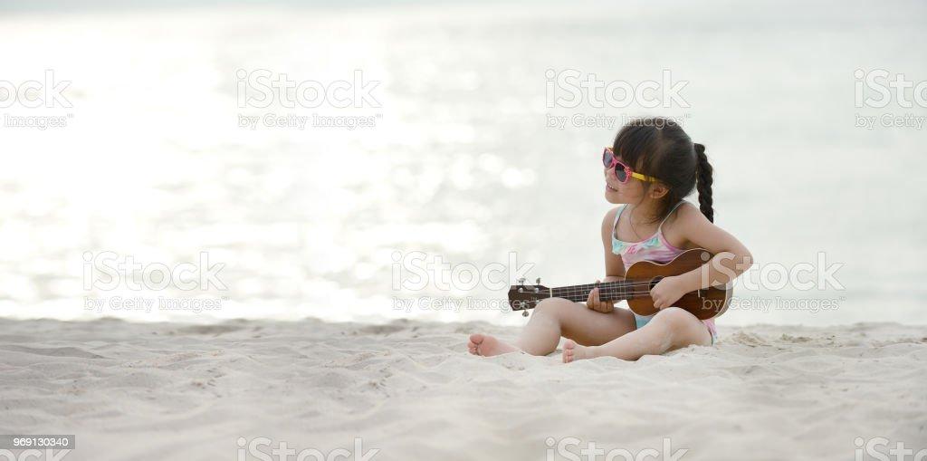 Happy family on vacation summer beach. stock photo
