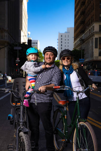Happy Family Out Riding Bikes in the City stock photo