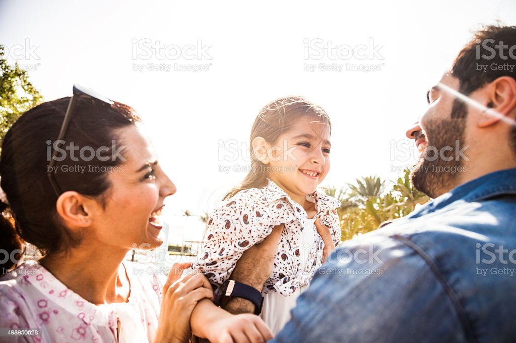 Happy family outdoor in a city park stock photo