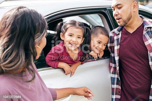 528474010istockphoto Happy family outdoor 1041372584