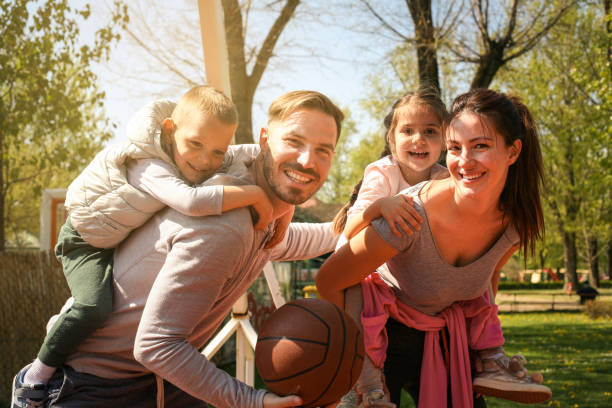 Happy family outdoor with basketballs. stock photo
