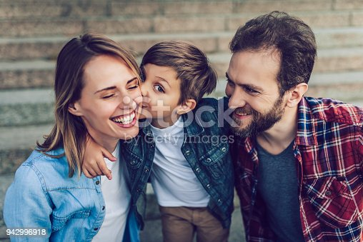 Happy family is having fun outdoors. Father, mother and son are spending time together.