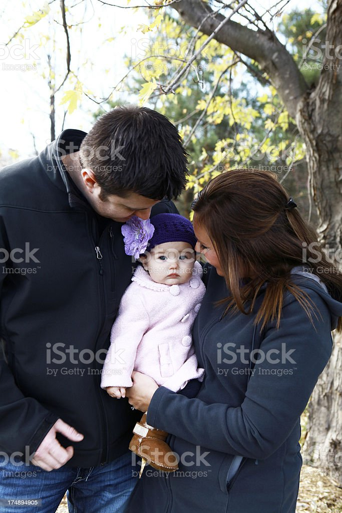 Happy Family Outdoors with Baby Girl royalty-free stock photo
