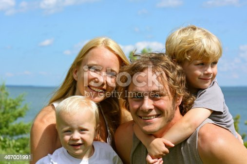 istock Happy Family Outside by Lake 467001991
