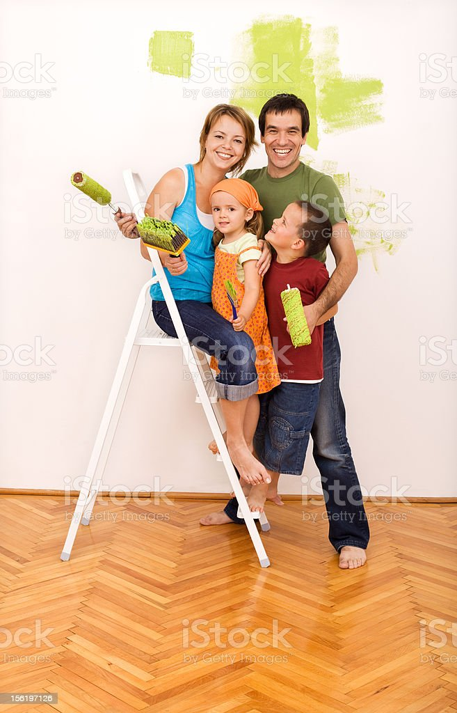Happy Family Painting Their New Home Together Royalty Free Stock Photo