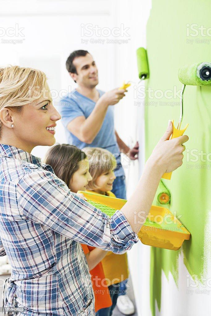 Happy family painting walls royalty-free stock photo