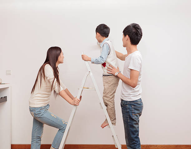 Happy Family Painting Walls Stock Photo