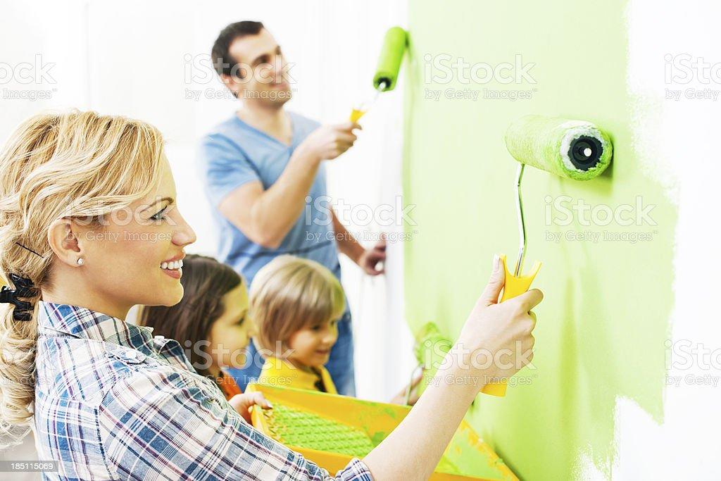 Happy family painting walls. royalty-free stock photo