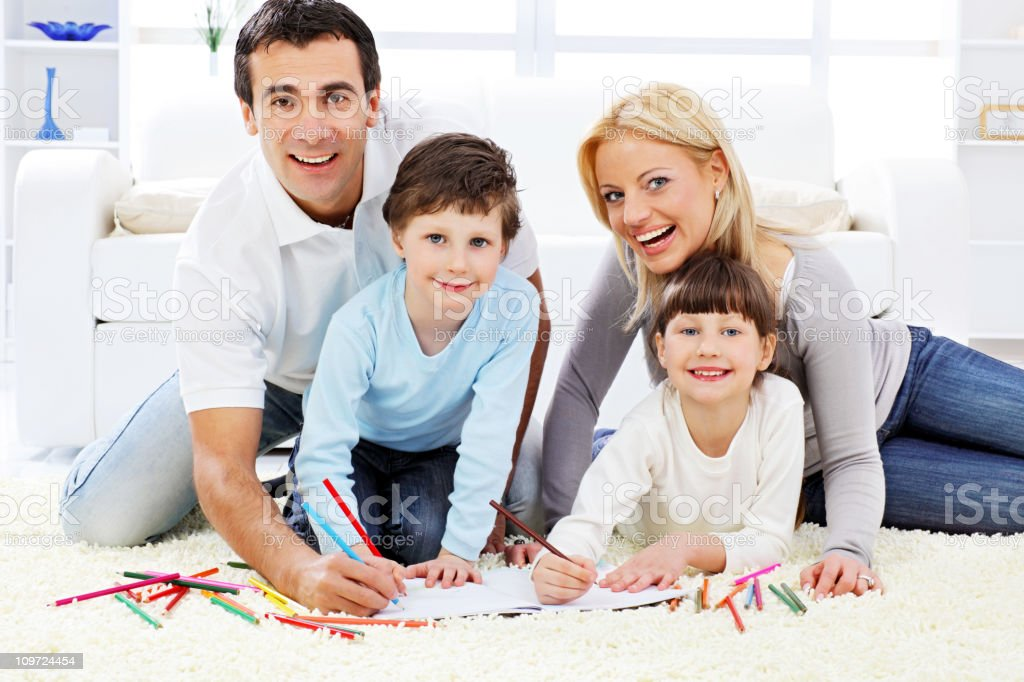 Happy family. Parent with children drawing in colorful pencils. royalty-free stock photo