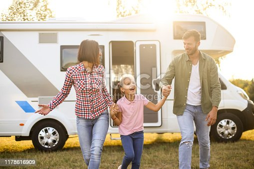 Family camping in a recreational vehicle. About 30 years old parents and a 8 years old daughter, all Caucasian people.