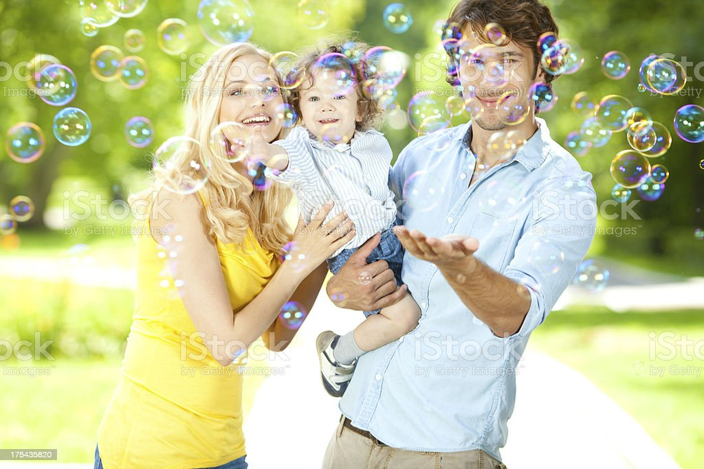 happy family happy young family playing with bubbles 12-17 Months Stock Photo