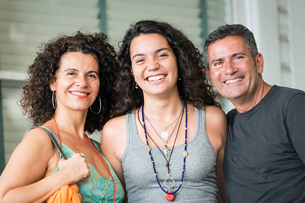 Happy Family Very Happy parents posing with their daughter 18 19 years stock pictures, royalty-free photos & images