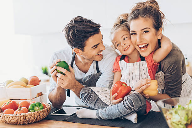 happy family - kids cooking stock photos and pictures