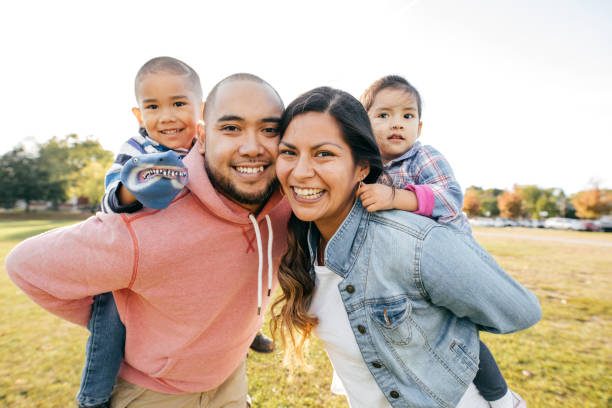 happy family - four people stock photos and pictures