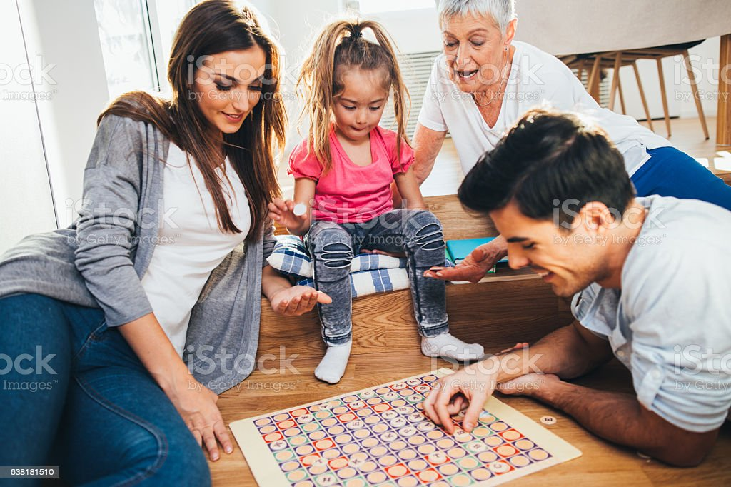 Happy family playing a game stock photo