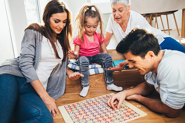 happy family playing a game - word game stock pictures, royalty-free photos & images