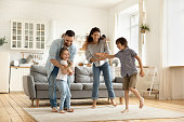 istock Happy family playing funny game having fun together. 1269761486
