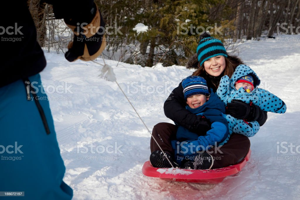 happy family playing in snow. royalty-free stock photo