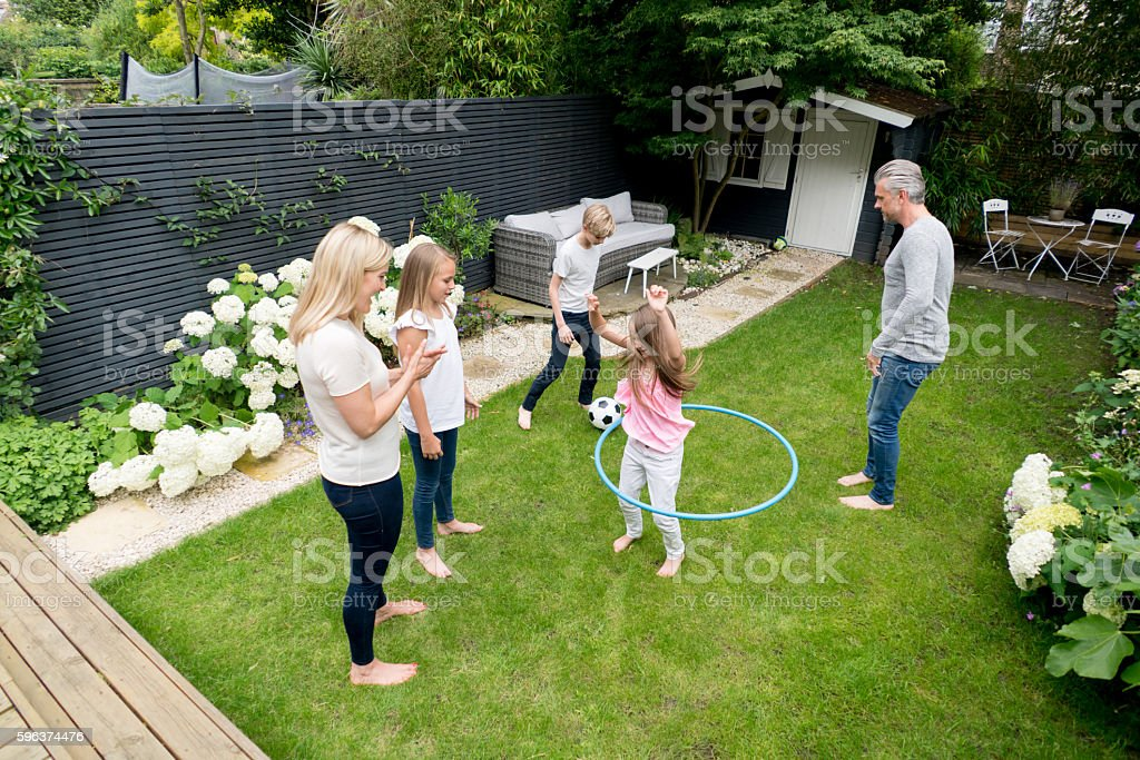 Happy family playing in the garden stock photo