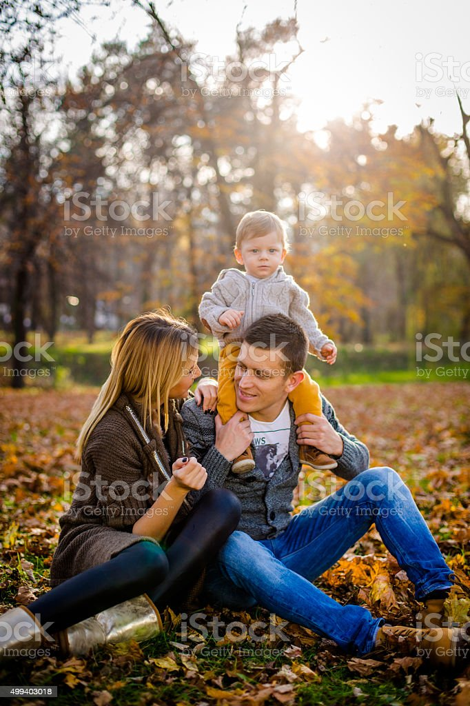happy family playing outdoors in autumn park stock photo