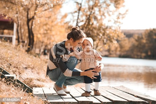 istock Happy family playing outdoors 618840534
