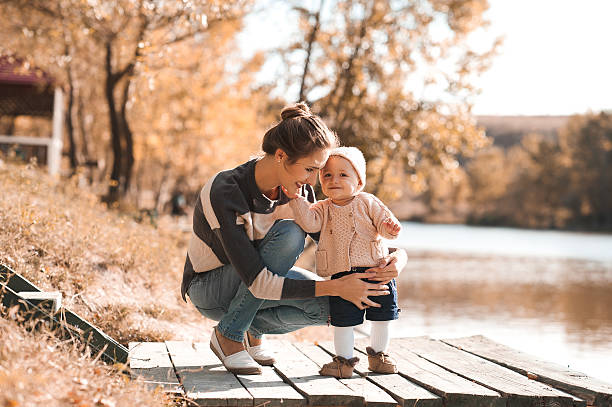 Happy family playing outdoors stock photo