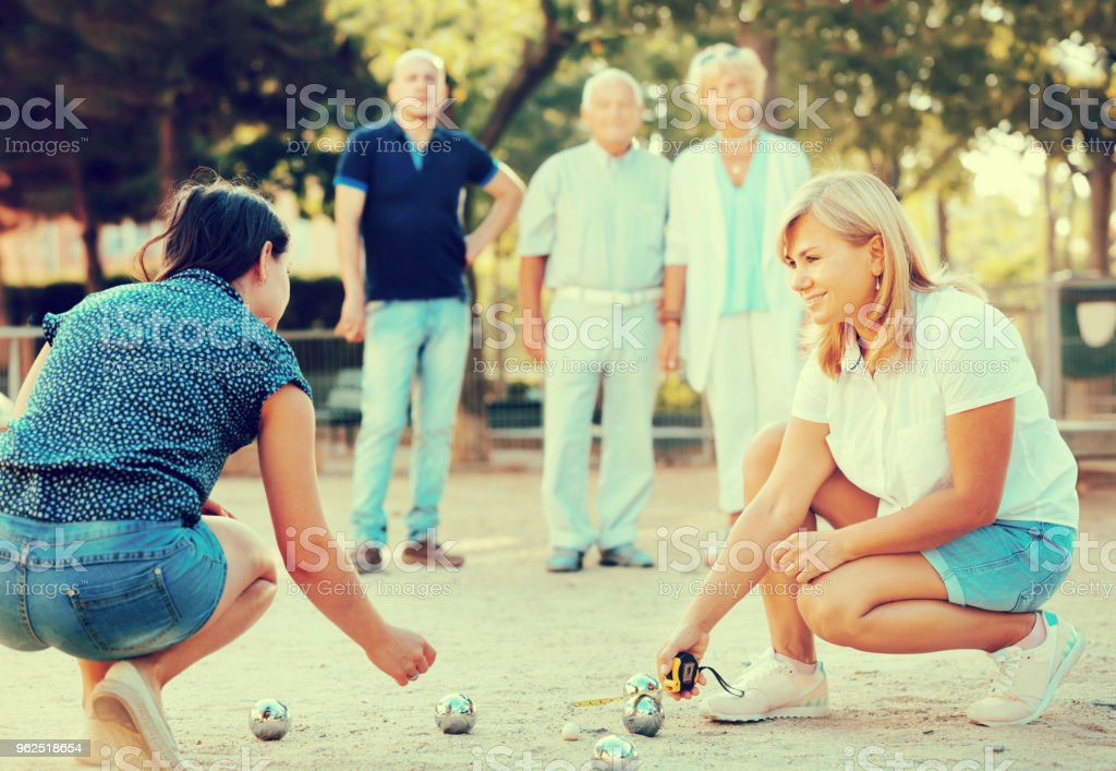 Happy family playing petanque in outdoor - Royalty-free Active Seniors Stock Photo