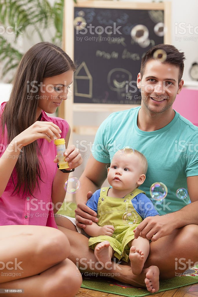 Happy family playing royalty-free stock photo