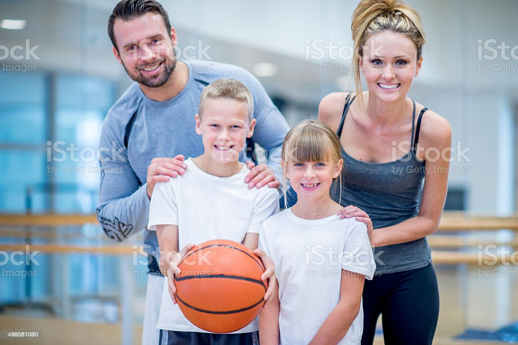 Happy Family Playing Sports stock photo