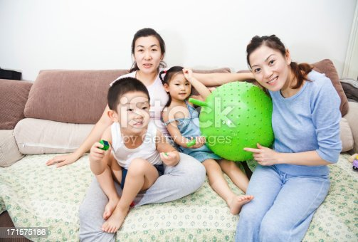 172407626 istock photo Happy family playing together at home 171575186