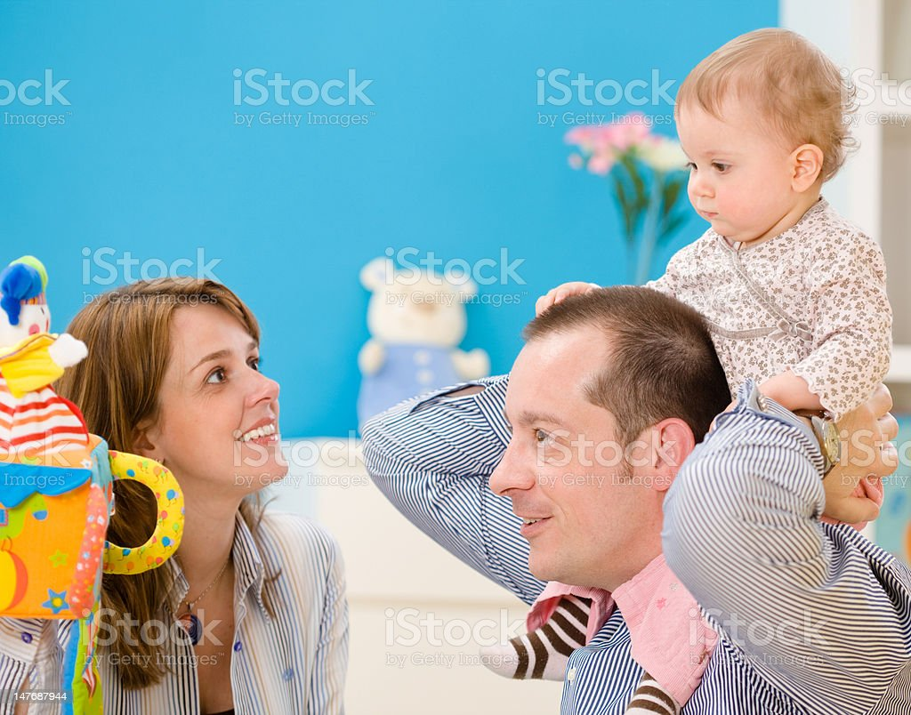 Happy family playing together royalty-free stock photo