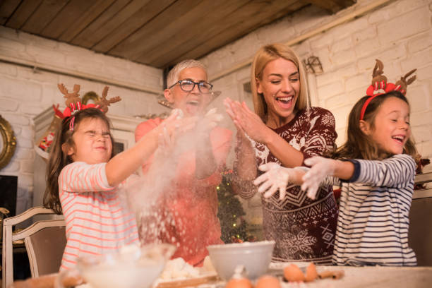 Happy family playing with baking powder Female part of the family making a cake together and having fun tradition stock pictures, royalty-free photos & images
