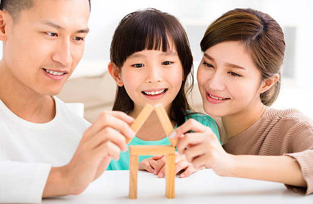 happy family playing with toy blocks stock photo