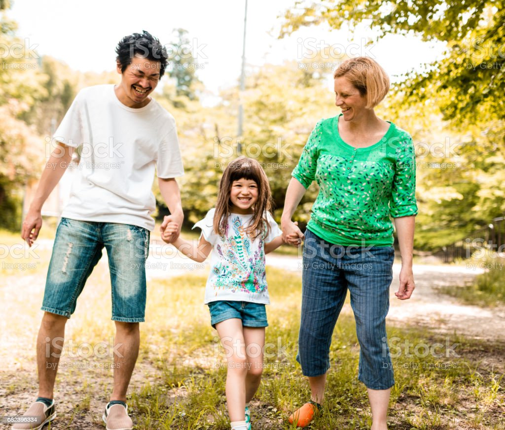 happy family portrait in the park royalty-free stock photo