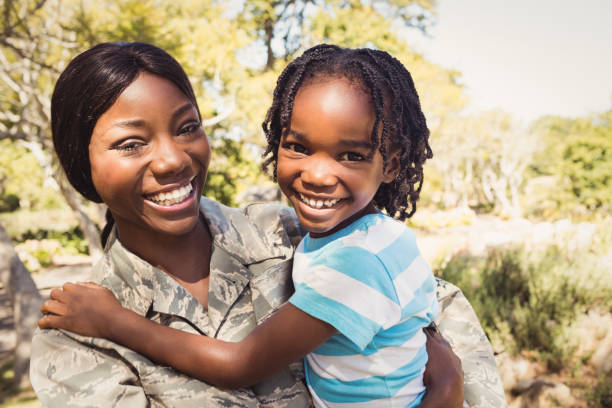 happy family posing together - military lifestyle stock pictures, royalty-free photos & images