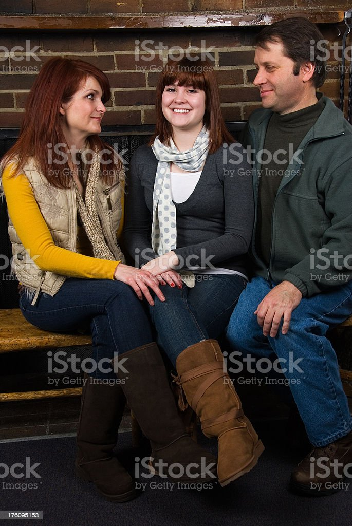 Happy family: Proud parents are looking at their daughter stock photo