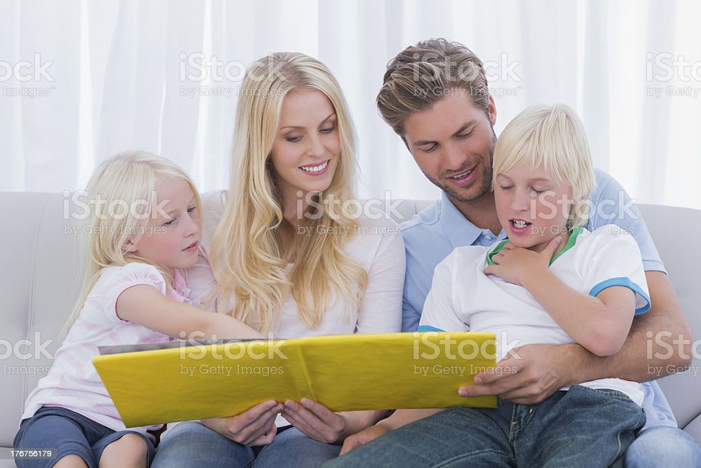 Happy family reading a story together royalty-free stock photo