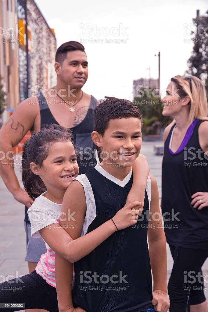 Happy family relax after exercising together in the city stock photo