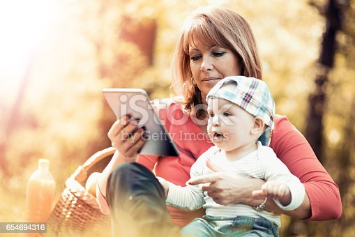 640349426istockphoto Happy family relaxing in the park,having fun. 654694316