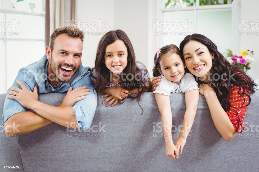 Happy family relaxing on sofa at home royalty-free stock photo
