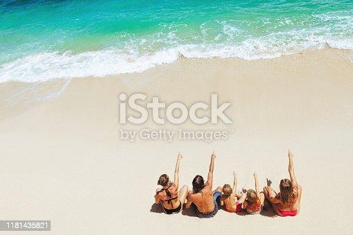 929671306 istock photo Happy family relaxing on white sand sea beach. 1181435821