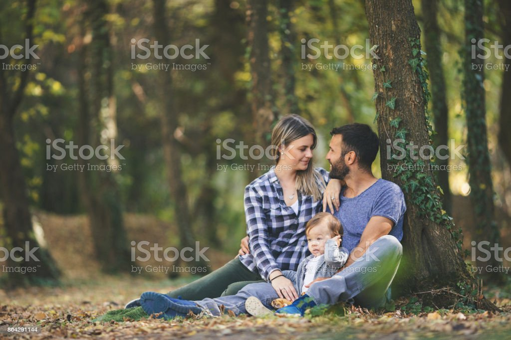 Happy family relaxing outdoors in nature royalty-free stock photo