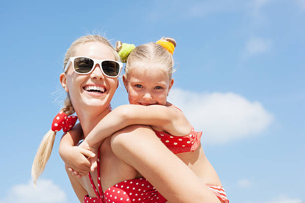 Happy family resting at beach in summer stock photo